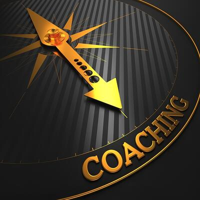 "Coaching - Business Background. Golden Compass Needle on a Black Field Pointing to the Word ""Coaching"". 3D Render."