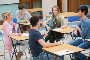 Students sitting in a classroom and talking while having fun
