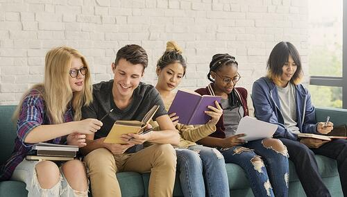 Diverse-Students-Sitting-on-Couch-Reading-Feature-Image.jpg