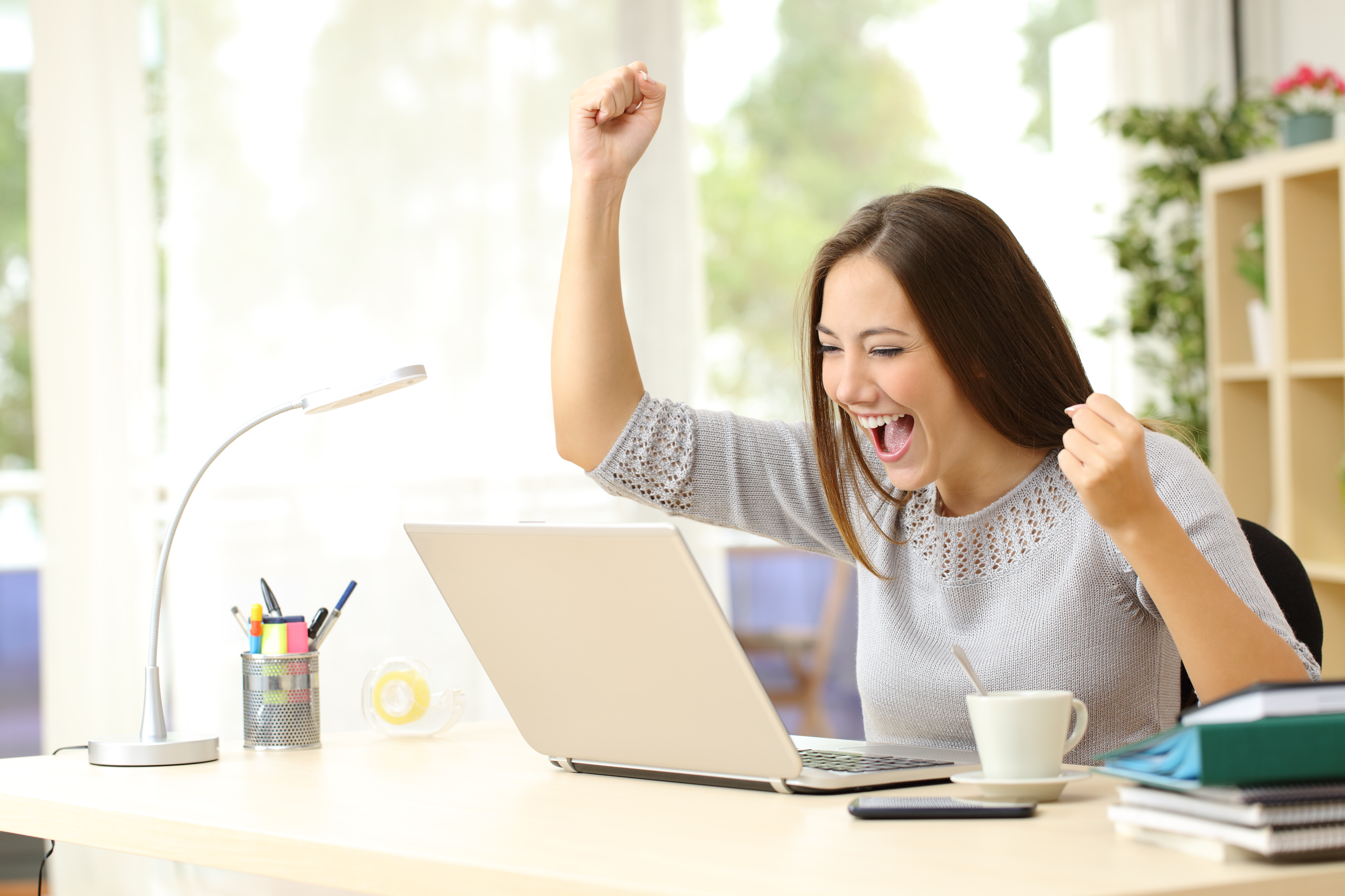 excited woman on the computer