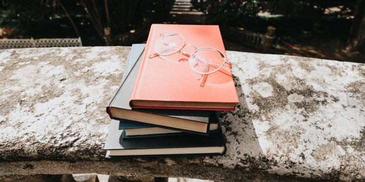 header_a-colorful-stack-of-books-and-glasses
