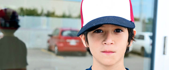 header_young-child-in-ball-cap