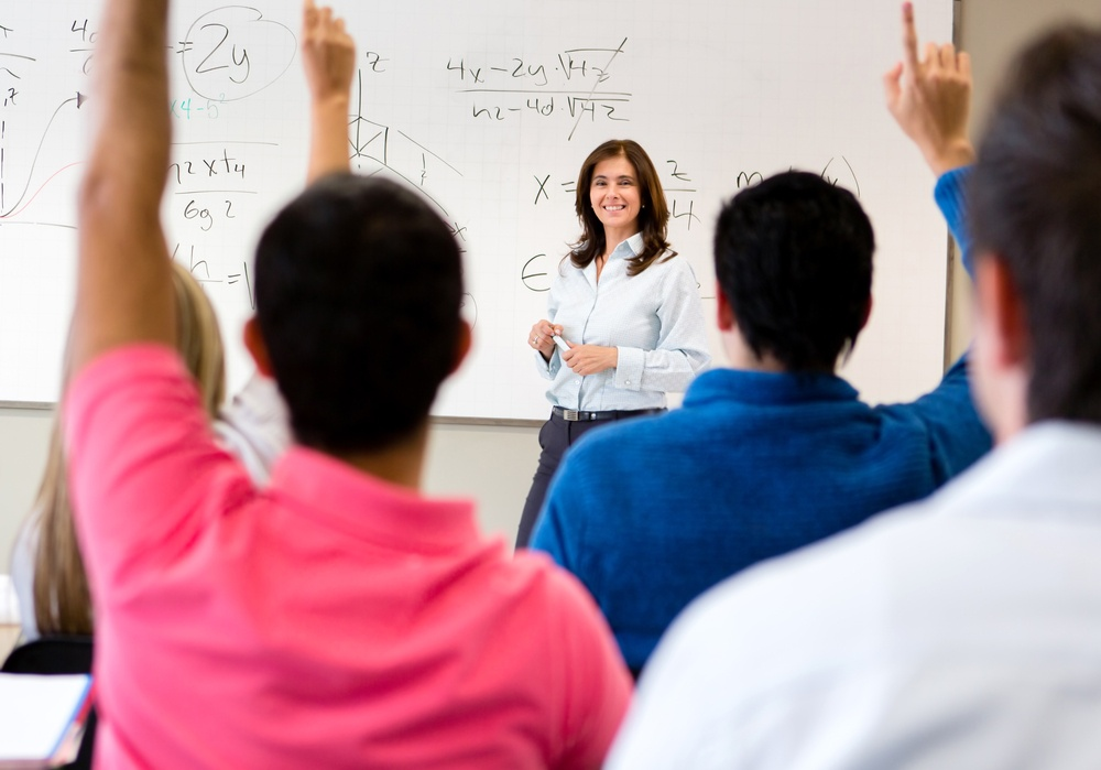 Students in class asking questions to the teacher